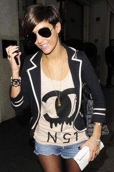 The night out cannot be worn better than Frankie Sandford as she wears a black and white blazor over a Chanel t-shirt with jeans and transparent black tights. The white clutch sets the outfit off.