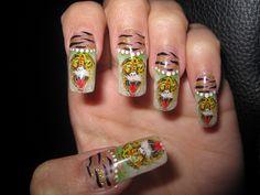 My Ed Hardy Nails by SANANTOGIRL, via Flickr