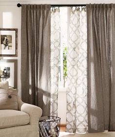 Give your windows depth! Layer curtains in the living room. Love this pattern and look!