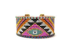 Tribal bead loom bracelet - evil eye bracelet, beaded bracelet, ethnic bracelet, neon bracelet, bead loom bracelet, friendship bracelet by distinguishedjewelry on Etsy https://www.etsy.com/listing/222839673/tribal-bead-loom-bracelet-evil-eye