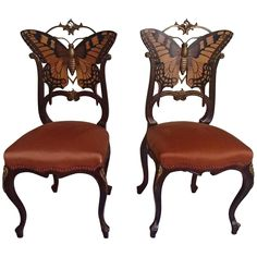 Pair of Early Art Nouveau Butterfly Chairs Inlays and Brass | From a unique collection of antique and modern side chairs at https://www.1stdibs.com/furniture/seating/side-chairs/