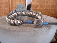 Wrapbracelet with silvercolored glassbeads on grey leather