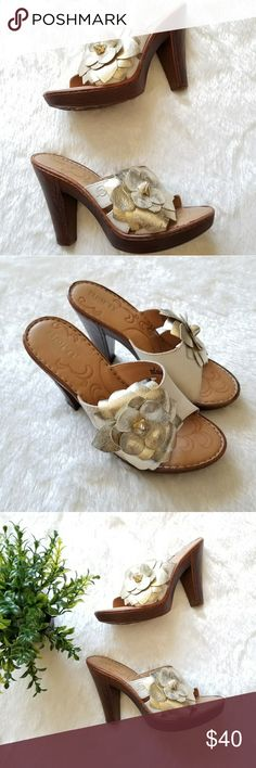NWOB Born Sandals!! Super cute Born heeled sandals with floral embellishment. Size 6. New condition. Comes from a smoke-free pet-free home. Fast shipping! NO TRADES! Born Shoes Sandals