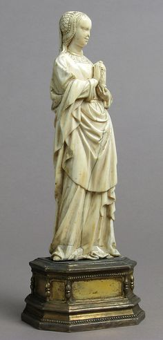 Mary Magdalene  Date: early 16th century Culture: French Medium: Ivory, modern silver-gilt base
