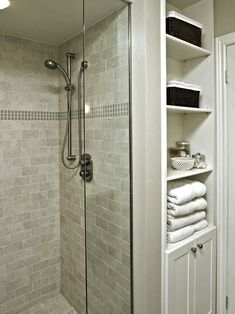 , Transitional Tiled Bathroom With Grey Shower Cubicle Also Modern Shower Head And Mixer Tap Also Modern White Rack And Cupboard Also White Towels Color Also Black Rattan Basket For Storage Case: Tiled Bathrooms for Comfortable Bathroom