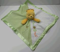 The item is a doll blanket of Pooh as the doll... the blanket is white and green with POOH written on half and a bee flying on the other.
