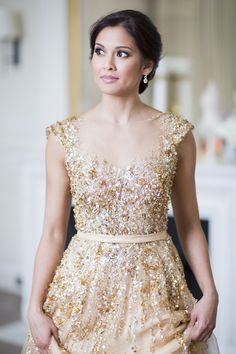Style Me Pretty — This sparkly gold wedding dress is absolute...