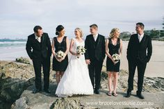 Classic black and white wedding party on the beach.