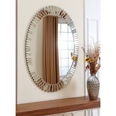 This Abbyson Living mirror will be a stylish addition to every room in your home. The unique design surrounding the outside of the mirror will enhance any decor well.