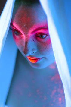 this looks like UV makeup under black light...