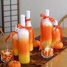 painted wine bottles halloween - I would Add branches that are spray painted orange or white and hang mini funkins from them for a centerpiece