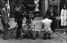 Jean-Luc Godard, Raoul Coutard, Laszlo Szabo and Anna Karina on the set of Made in USA., photographed by Bruno Barbey, 1966