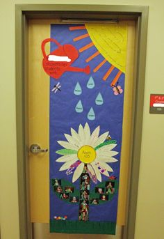 This could be another door that is great for the first day of school! The teacher could put her expectations on the rain drops, and the students could put their goals on the flower petals! :)