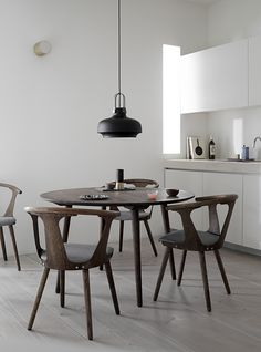 Kitchen dinning room in smoked oak. In Between table and Chairs by Sami Kallio. Copenhagen Pendant by Space Copenhagen.