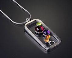 This necklace has five beautiful cabochons in different sizes. Very colorful and stylish. Great for the office or for a night out. The silver used is tarnish resistant Argentium sterling silver except