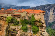 METEORA. Greece. Precariously perched atop pinnacles of sandstone, 1300 feet high, Meteora's six Greek Orthodox monasteries tower over the city of Kalambaka in central Greece. They're centuries old—dating to the 9th century—from a time when Byzantine hermit monks, who lived in Meteora's caves, were forced to move to safety at these heights.