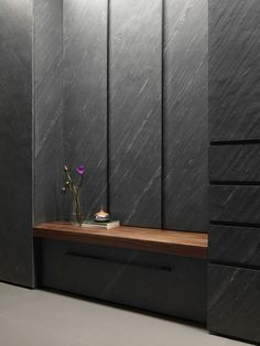 A Midcentury-Inspired House with a Few Fun Accents black-stone-wall-treatment Interior Door Knobs, Interior Shutters, Wood Shutters, Stone Cladding, Wall Cladding, Niche Design, Stone Wall Design, Diy Wood Wall, Marble Wall