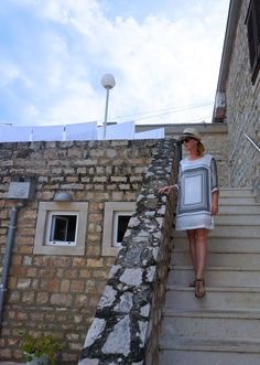 Vacation style in a white dress from Mango and a straw hat bought in Hvar, Croatia