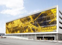 Rob Ley of Urbana Studio, an interactive art facade made from 7,000 angled metal panels attached to a parking structure at the new Eskenazi Hospital in Indianapolis, Indiana.