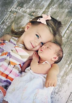 Capturing the instant bond between sisters in this newborn photo session. <3
