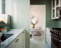 Pretty kitchen and a peek into rhe dining area. Love pastel/medium shades. Mini green subway tile | the perfect color