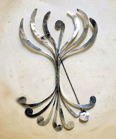 Alexander Calder: pin, twisted silver and stainless steel wire