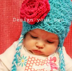Crochet Flower Embellished Hat with Ear flaps and Braids for Babies via Etsy.