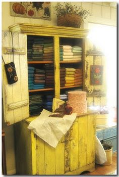 Primitive cupboard used for wool storage and display     Red House Wool Studio.blogspot.com