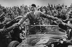 I chose this picture to represnt the rise of Hitler. This picture shows him being cheered for and praised by the Germans. Most people didnt know he was going to do what he did and he made so many promises that everyone looked to him as a god.