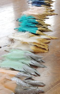 These Gold Glitter Dipped Feathers are absolutely beautiful! Use them for décor at any event or display them in your home. They measure 5 1/2 - 8 inches. Also available as a garland/backdrop as shown in last photo. Feathers available in many colors. Glitter available in silver, gold, or rose gold also. When making these, I pay close attention to each detail to make each one as I would for myself. The feathers are spread at the tips when being hand painted with metallic gold paint. Then they…