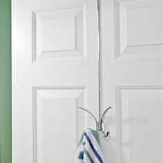 Solutions - X-Long Over-Door Hook.  Easy for the kids to reach their towels...