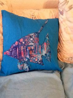 Fish appliqué pillow; pillow insert is poly-fil. Cover is handmade appliqué made with batik print fabric. Measures 16X16 inches. Note eyelash and lip detail making this a very unique fish
