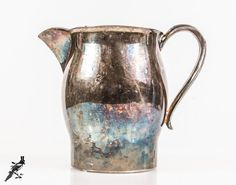 Water / Milk Pitcher 2 Quart Vintage B Rogers Silverplate USA Mid Century Silver Plate - Chic Vase or Utensil Jar by TheCordialMagpie from Etsy. Find it now at http://ift.tt/242Y2wW!