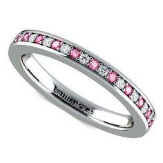 Pretty in pink: Treat the blushing bride to timeless sweetness with the Pave Diamond and Pink Sapphire Eternity Band in White Gold! www.brilliance.com