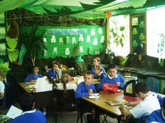 """""""Every year, in the summer term, the Year 6 children undertake a project based upon rainforests. To provide a real sense of involvement the Y6 classrooms and corridors are transformed into an incredible jungle of canopies, tropical plants, animals, and other sights and sounds of a tropical rainforest."""""""