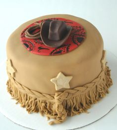 Little Cowboy Cake...Possibly shower cake idea...the khaki as the bottom layer, and with the stars deep red or dark brown to match a big hat on top of a cowprint layer??