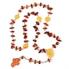 """Simple Honey Amber Rosary Item No. AM01007A01 $58.09 This beautiful and elegant amber rosary is comprised of honey and butterscotch amber. Beads connected with sterling silver links of chain. Rosaries measure about 23"" long plus 4 1/2"" of hanging drop. Amber cross on the end of the rosaries measure about 1"" x 5/8"". The amber comes from the Baltic region of Russia and is lightly tumbled to give it a nice polish, without losing the natural aesthetic of the amber."