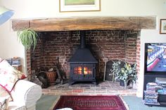 Hunter wood burning stove fitted into an old Essex inglenook by Scarlett Fireplace in Eastwood 2012 This installation can be viewed on our youtube page