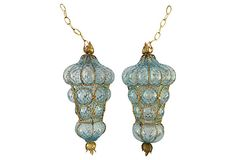 "Incredibly gorgeous and rare pair of 1950s Murano glass pendants in aquamarine lattice pattern with gilt rope caging and acanthus leaf finials. Unsold store stock professionally wired with porcelain sockets. Each holds one standard bulb. One pendant is tagged: ""Venetian Glass, Balboa, Hand Made in Italy."" 36""L chain, new brass ceiling canopy and mounting hardware included."