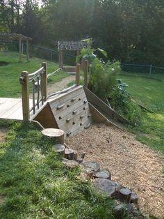 Kid friendly garden ideas... LOVE the climbing wall part.