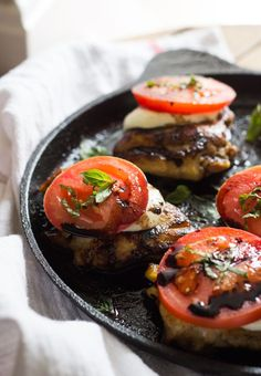 20-Minute Easy Skillet Chicken Caprese - juicy, tender, chicken thighs topped with mozzarella, tomato, basil and balsamic reduction. Effortless and delicious chicken dinner! | littlebroken.com @littlebroken