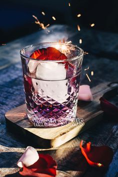 Ink Gin gives this cocktail a beautiful purple tint teamed for red rose petals and sparklers is a cause for a celebration! If you like my content follow my instagram @kasiasykusphoto