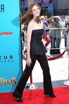 Elle Fanning wearing black pants and a strapless top at a premiere in L.A. See all of the actress's best looks.