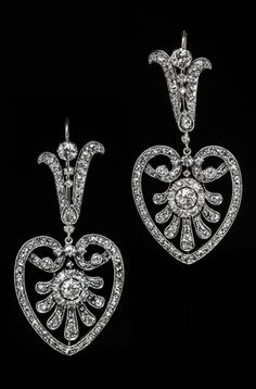 A pair of Belle Epoque silver-topped gold and diamond earrings, circa 1880. Finely handcrafted in silver-topped gold and set with old European-, old mine- and rose-cut diamonds.