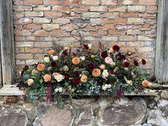 Old Mill Wedding, old stonework. Locally sourced wedding. Locally grown flowers. Burgundy, peach, coral, yellows, creams, dahlias, ranunculus, amaranths, roses.