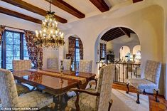 A little more formal: The dining room features luxurious elements, including a low-hanging chandelier