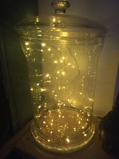 Fairy lights in a giant jar for a night time table centre piece
