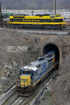 "The Virginian heritage unit is seen stopped at CP ""Rockdale"" at Inman Yard, awaiting a new crew to complete its journey from Knoxville to Macon. CSX's ex ACL mainline exits their parallel Tilford Yard via a tunnel under Inman, and here we see local train A727 departing Tilford, bound for Union City. In Georgia, Norfolk Southern has 4,761 employees and operates 1,778 miles of track."