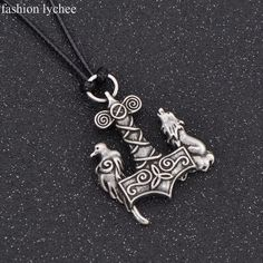 Beautiful Viking necklace with a Wolf and Raven standing on a traditional Thor's Hammer. Viking Clothing, Viking Jewelry, Wiccan Jewelry, Norwegian Tattoo, Scandinavian Tattoo, Plugs Earrings, Viking Symbols, Necklace Types, Sterling Silver Jewelry