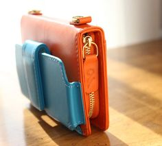 Fashion collides with mobility with the Orange/Turquoise Kayla Clutch.  case-mate.com/cm